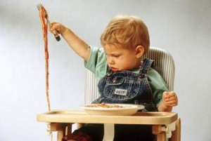 Child with spaghetti