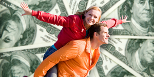 Portrait Young love Couple smiling under money, 100 american dol